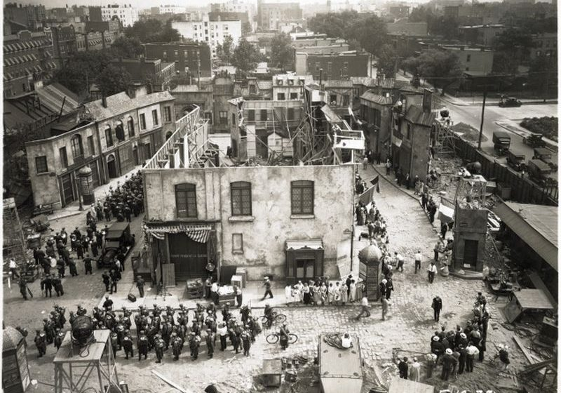Courtesy Queens Historical Society An amazing photograph showing the filming of the World War I drama, The Battle of Paris, in 1929 on the Astoria Studio backlot. The Astoria neighborhood can be seen beyond the walls of the backlot where a replica of Paris had been erected.