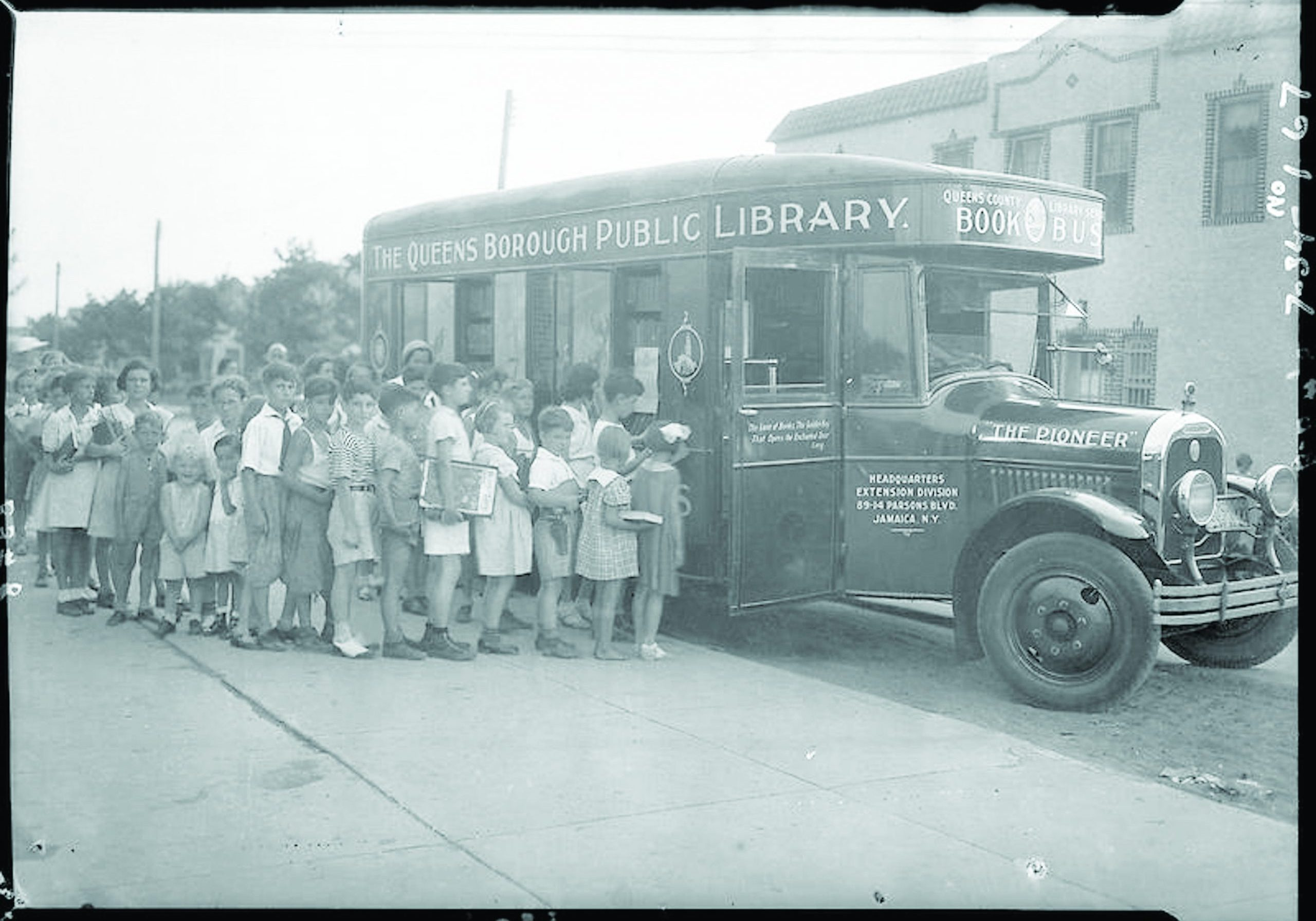 Photo Courtesy Queens Public Library Archives Youngsters line up for the Queens Public Library book mobile during its summer reading program circa 1925.